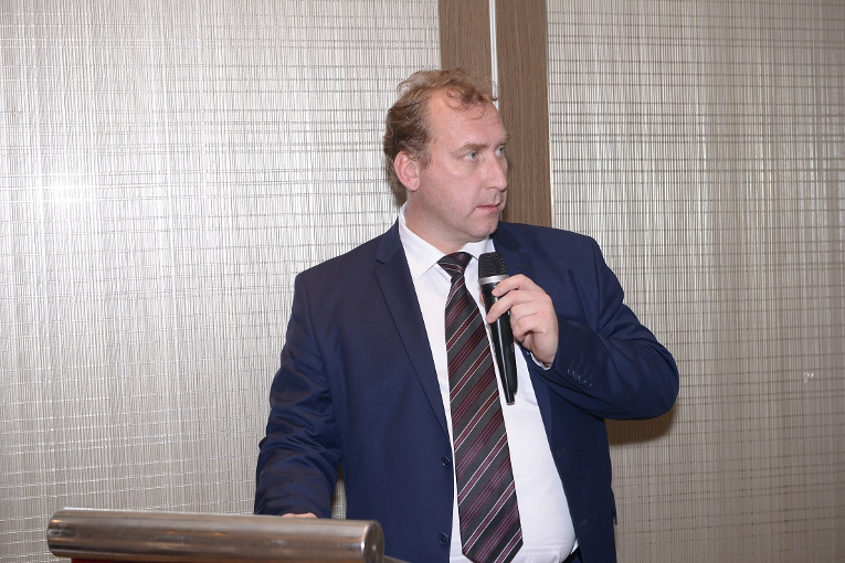 D. Egorov, Deputy Director of Export Department at Uncomtech trading is making a report