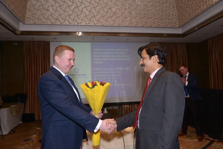 Awarding Thank-you bouquets to the Indian partners on behalf of Izolyator