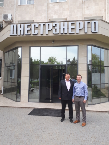 General Director of Valkiria Ltd Ivan Lupashko (L) and Dmitry Karasev in front of the head office of SUE GC Dnestrenergo