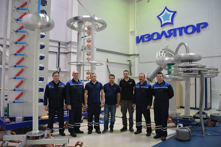 Experts who installed the surge generator of Haefely Test AG at the test center of Izolyator, in the center — Dmitry Ivanov