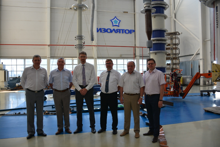 RusHydro Group representatives at the test center of Izolyator plant, L-R: Konstantin Sipilkin, Alexander Slavinsky, Deputy Chief Engineer at RusHydro Group Dmitry Kolesnikov, Head of Electrical Equipment Directorate at RusHydro Group Alexander Okhrim, Vladimir Ustinov and Oleg Bakulin