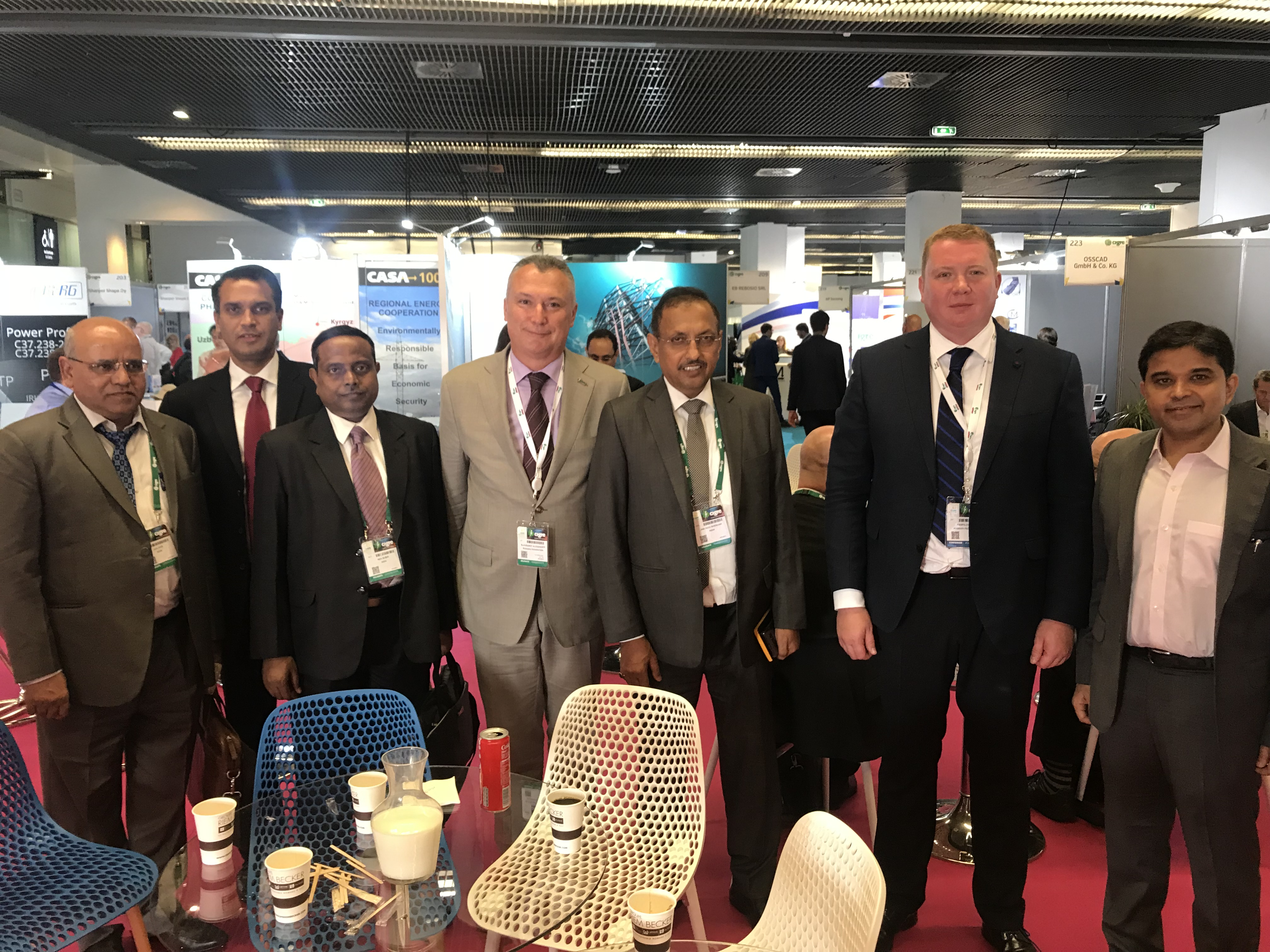 Trilateral meeting at the 47th CIGRE Session. Center – Chairman of the Board of Directors at Izolyator Alexander Slavinsky, L-R: Chairman and General Manager of PowerGrid I. S. Jha (I.S. Jha), Commercial Director and 1st Dpty CEO at Izolyator Ivan Panfilov and Executive Director at Mehru Electrical & Mechanical Engineers (P) Ltd. Sandeep Prakash Sharma