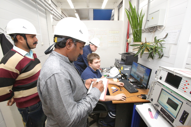 Test inspection of high-voltage bushings by Indian specialists at Izolyator plant