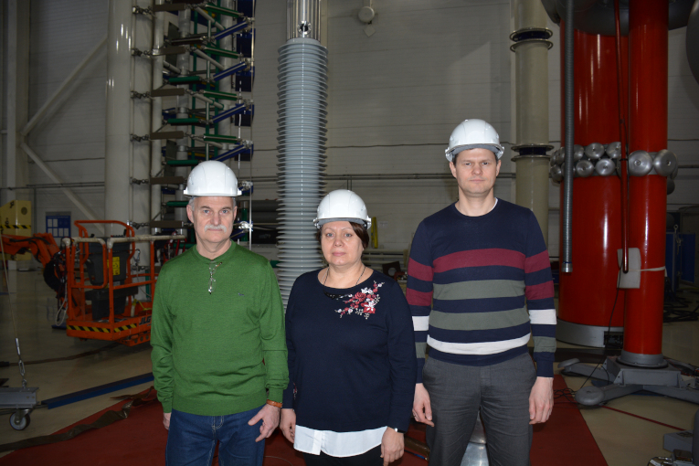 Participants of the Izolyator High-Voltage bushings Inspection, manufactured for the Leningrad NPP, L-R: Leonid Takhtarov, representative of Leningrad NPP, Tatyana Golkina, representative of VO Safety JSC, and Konstantin Ivanov, head of department at Favorstroy
