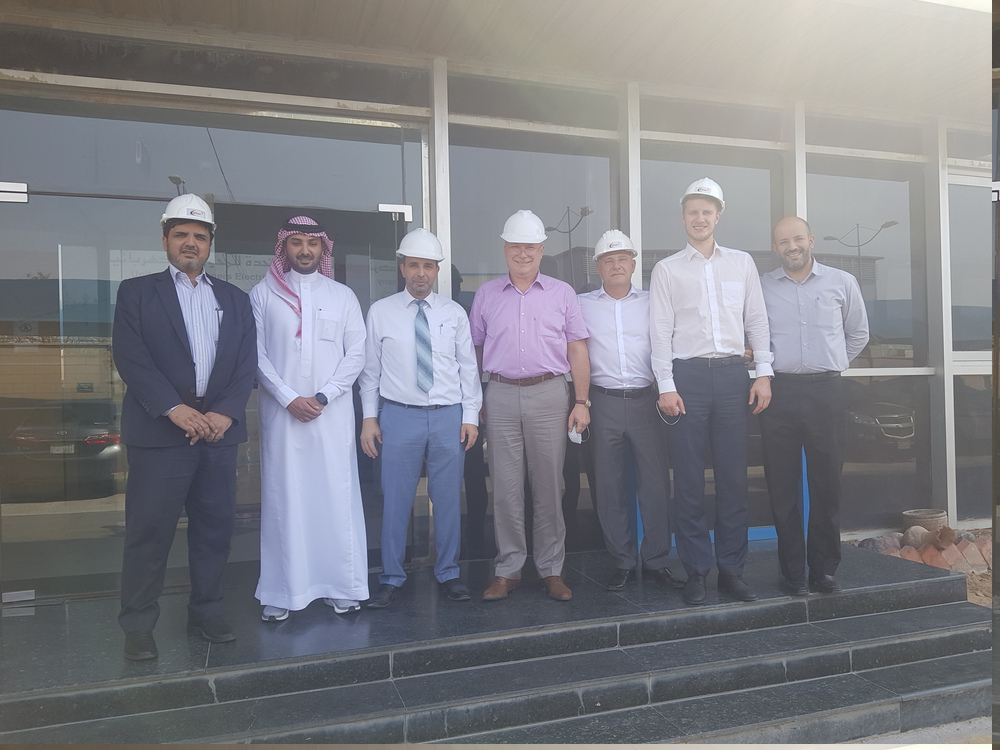 Participants of the talks at the United Transformers Electric Company's transformer plant in Saudi Arabia